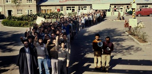 Crowd of Iranian men stand outside the U.S. Embassy compound in Tehran, Iran, where a number of U.S. citizens were taken as hostages, Nov. 1979.