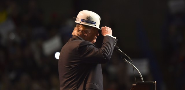 Donald Trump wears a coal miner's protective hat while addressing supporters at a rally in Charleston, W.V., last May.