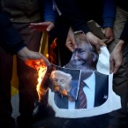 Iranian protesters burn portraits of U.S. President Donald Trump during a rally against U.S. President Donald Trump's decision to recognize Jerusalem as the capital of Israel, in Tehran, Iran, Monday, Dec. 11, 2017.