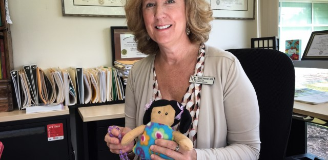 Marie Sandusky directs student health services at the University of Arkansas at Little Rock. In an orientation session, rag dolls are handed out to symbolize the number of students who will become parents this year if they don't practice safe sex or use birth control.