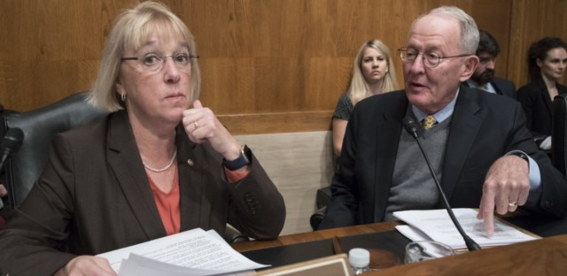 Sen. Patty Murray, D-Wash., and Sen. Lamar Alexander, R-Tenn., leaders of the Senate Health, Education, Labor, and Pensions Committee, meet before the start of a hearing on Capitol Hill.