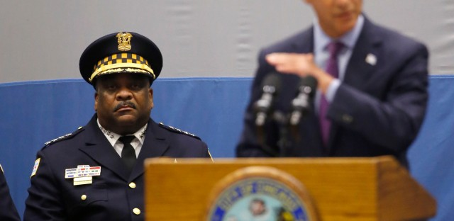 Chicago police superintendent Eddie Johnson, left, listens to mayor Rahm Emanuel deliver his new public safety plan to combat gun violence on Sept. 22, 2016. Mayor Emanuel announced a $36 million mentoring initiative for thousands of youths from high-crime neighborhoods and asked for the community's help to fight and prevent violence in the nation's third-largest city.