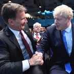 "Jeremy Hunt, left, congratulates Boris Johnson after the announcement of the result in the ballot for the new Conservative party leader, in London, Tuesday, July 23, 2019. Brexit hardliner Boris Johnson won the contest to lead Britain's governing Conservative Party on Tuesday and will become the country's next prime minister, tasked with fulfilling his promise to lead the U.K. out of the European Union ""come what may."""