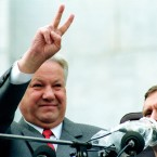 Russian Republic President Boris Yeltsin makes a V-sign at the start of the rally attended by tens of thousands of people to celebrate the failed military coup in Moscow, Thursday, Aug. 22, 1991.