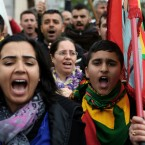 Kurdish demonstrators who live in Cyprus, shout slogans, and hold flags during a protest against the Turkish offensive targeting Kurds in Afrin, Syria, outside of the U.S embassy in Nicosia, Cyprus, Wednesday, Jan. 24, 2018.