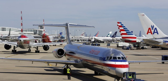 An American Airlines jet is pushed back from its gate at O'Hare International Airport.
