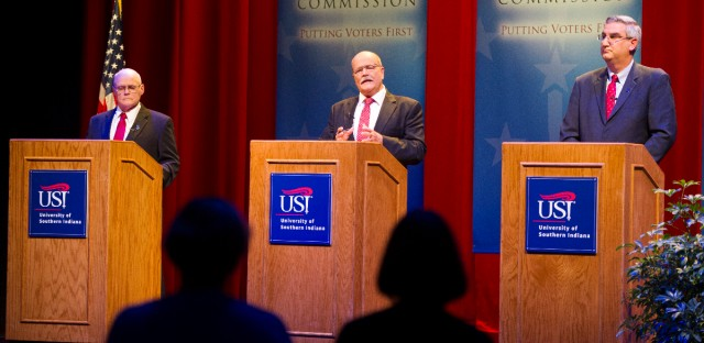 The three candidates for Indiana governor, left to right, Libertarian Rex Bell, Democrat John Gregg, and Republican Lt. Gov. Eric Holcomb participate in a debate, Tuesday, Oct. 25, 2016, in Evansville, Ind..