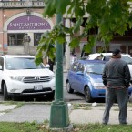 Smaller Size Image: Two men talk in front of the 119-year-old Saint Anthony Hospital on 19th Street in Chicago's Marshall Square neighborhood, in October 2017. (AP Photo/Charles Rex Arbogast)