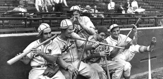 In this Sept. 30, 1938 file photo, Rip Collins, Chicago first baseman and former Cardinal, joined his old teammates in a burlesque of John Pepper Martin's mudcat band in St. Louis, from left, Stan Bordagaray, Bill McGee, Collins, and Pepper himself are dancing out a on their bats, while Bob Weiland (standing, rear) finds his glove sufficient.