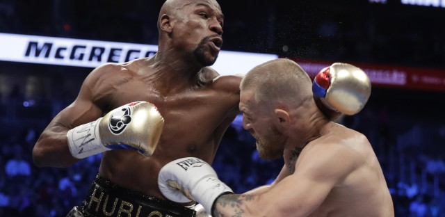 Floyd Mayweather, left, defeated Conor McGregor in a super welterweight boxing match Saturday in Las Vegas.