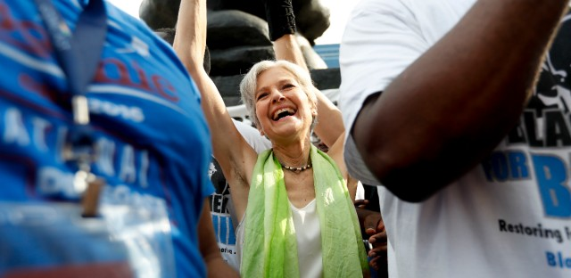 Dr. Jill Stein, presumptive Green Party presidential nominee, waves at a rally in Philadelphia during the third day of the Democratic National Convention.