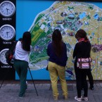 Tourists look a tourist map in Sultanahmet tourist area of Istanbul, late Tuesday, June 4, 2013.