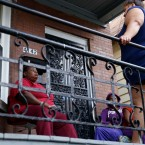 Yvette Ruffin, left, talks to neighbors at her home where her son Travis was shot Thursday, Sept. 1, 2016, in Chicago. Chicago saw its deadliest month in two decades in August, recording 90 homicides for the month, the city's police department said Thursday.
