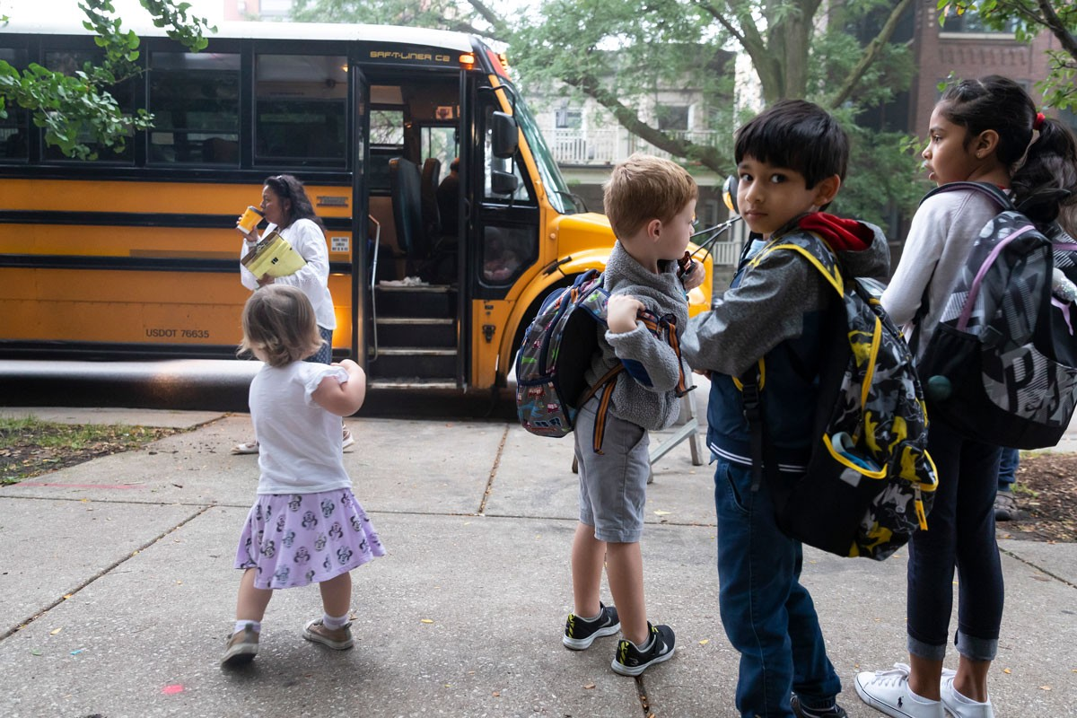 Students wait to board the bus to ride to magnet and test-in schools from Helen C. Peirce School of International Studies, a neighborhood school in Chicago's Andersonville neighborhood.