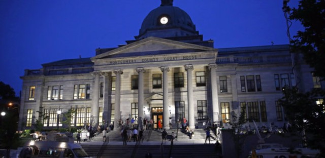 People gather on the steps of the Montgomery County Courthouse in Pennsylvania this week as jury deliberations in Bill Cosby's sexual assault trial take place.