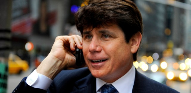 In this Jan. 27, 2009 file photo, then-Illinois Gov. Rod Blagojevich speaks on his cell phone before making an appearance in New York on a television program.