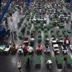 Evacuees fill up cots Monday at the George Brown Convention Center in Houston