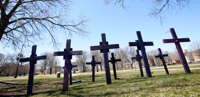 In this Thursday, April 19, 2018 file photo, crosses representing victims of gun violence stand outside Collins Academy High School in Chicago's North Lawndale neighborhood. With frustration mounting over lawmakers' inaction on gun control, the American Medical Association on Tuesday, June 12, 2018, pressed for a ban on assault weapons and came out against arming teachers as way to fight what it calls a public health crisis.