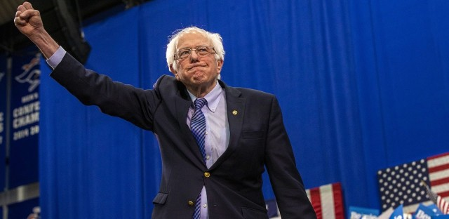 Bernie Sanders raises his fist in victory after the New Hampshire primary. Sanders is in the pole position for the Democratic nomination.