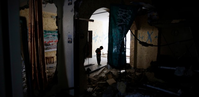 A Palestinian child walks through the home of Ehab Maswada that was demolished by the Israeli army in the West Bank city of Hebron, Thursday, March 31, 2016. Maswada fatally stabbed an Israeli civilian in the West Bank city of Hebron late last year. Israel says home demolitions are an effective tool to deter attacks, but critics say the tactic amounts to collective punishment.