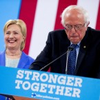 Sen. Bernie Sanders, I-Vt., accompanied by Democratic presidential candidate Hillary Clinton, speaks during a rally in Portsmouth, N.H., Tuesday, July 12, 2016, where Sanders endorsed Clinton for president.