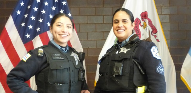 "Officer Diana Lozano and her Field Training Officer Claudia Guzman together at the Chicago Police Training Academy in December 2019. Lozano says ""every day"" she learns something new every day from her field trainer."