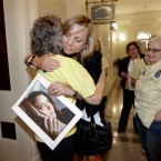 In this Sept. 9, 2015, file photo, Debbie Ziegler holds a photo of her late daughter, Brittany Maynard, as she receives congratulations from Ellen Pontac, left, after a right-to die measure was approved by the state Assembly in Sacramento, Calif. California will become the fifth state to allow terminally ill patients to legally end their lives using doctor-prescribed drugs after Gov. Jerry Brown announced Monday, Oct. 5, 2015 he signed one of the most emotionally charged bills of the year.