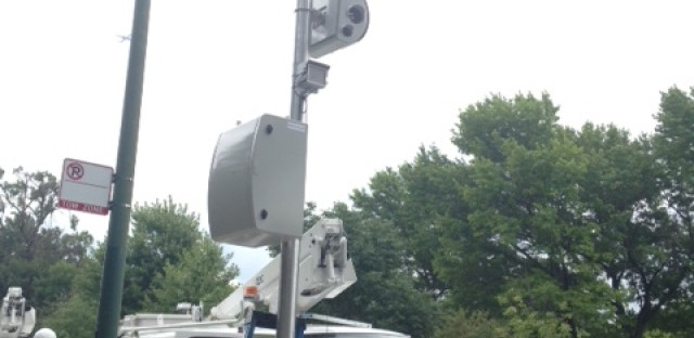 File: Workers install new speed cameras in August near Gompers Park, on Chicago's North Side.