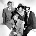 "This is a 1933 file photo of the Marx Brothers, frim left, Zeppo, Harpo, Chico and Groucho. The movie ""Horse Feathers"" is a Marx Brothers classic. The new president of Huxley College recruits players out of a local bar to help beat rival Darwin. The best part? How about Chico calling out signals such as: ""High diddle diddle the cat and the fiddle, this time I think we go through the middle."""