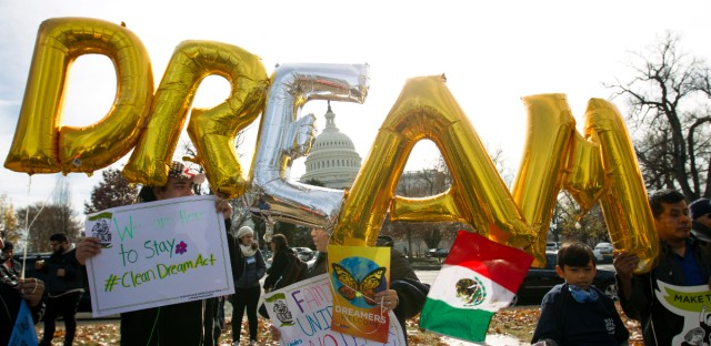 Demonstrators hold up balloons during an immigration rally in support of the Deferred Action for Childhood Arrivals (DACA), and Temporary Protected Status (TPS), programs, near the U.S. Capitol in Washington on Dec. 6, 2017.