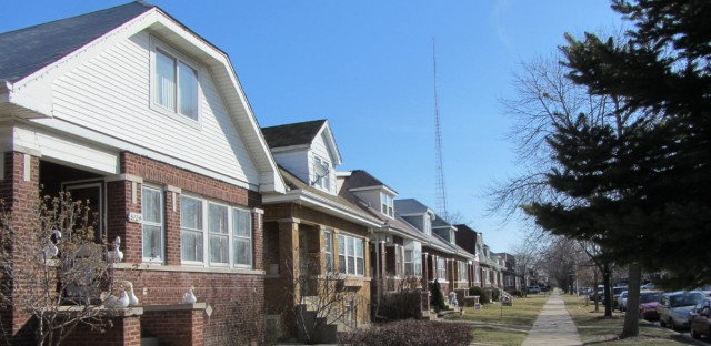 Homes line Fletcher Street on Chicago's Northwest Side. A controversial tax program started to prevent white flight in the area more than 30 years ago is shifting its mission.
