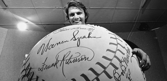 Boston Red Sox southpaw Bill Lee holds a large baseball before the start of fifth World Series game against the Cincinnati Reds at Riverfront Stadium in Cincinnati, Ohio, Thursday, Oct. 16, 1975. (AP)