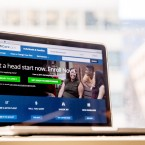 The HealthCare.gov website, where people can buy health insurance, is displayed on a laptop screen. Land of Lincoln, a nonprofit co-op, was one of 23 established under the Affordable Care Act.