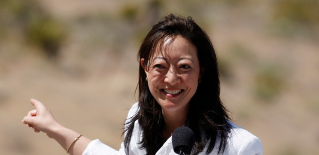"""Then-Assistant Secretary of the Interior Rhea Suh helps Michelle Obama promote the """"Let's Move Outside"""" program at Red Rock Canyon National Conservation Area outside Las Vegas Tuesday, June 1, 2010 in Red Rock Canyon."""