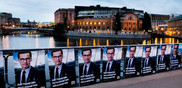The Aug. 30, 2018 photo shows election posters of Moderate Party's Ulf Kristersson in front of the Swedish parliament in Stockholm, Sweden. Sweden's 7.3 million voters go to polls on Sept. 9, 2018 to elect a new parliament and government