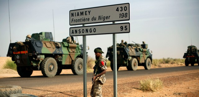 French armoured vehicles heading towards the Niger border before making a left turn north in Gao, northern Mali on Feb. 6, 2013.