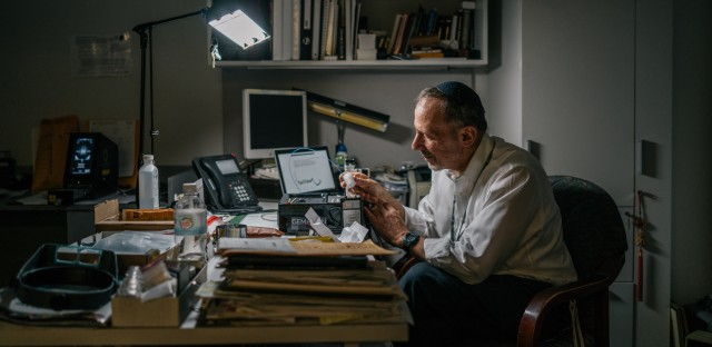 David Weinstein checks the origins of a selection of diamonds at the International Gemological Institute offices in Manhattan.
