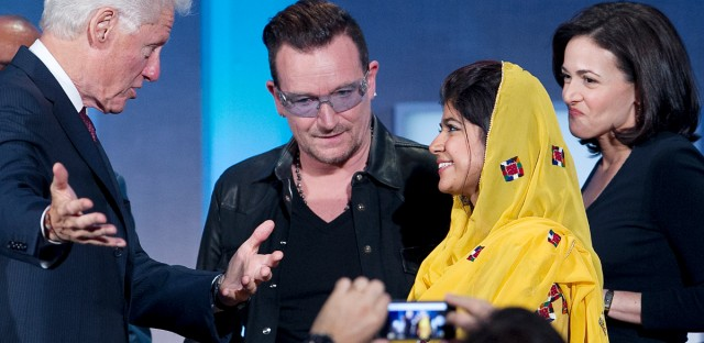 Former President Bill Clinton, left, talks with Bono, Khalida Brohi, founder of the Sughar Empowerment Society in 2013.