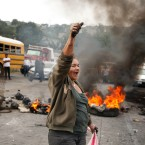 An anti-government protestor chants slogans against Honduras President Juan Orlando Hernandez as protesters block a road on the outskirts of Tegucigalpa, Honduras, Thursday, Dec. 7, 2017.