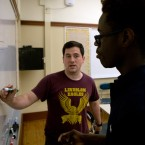 Bill Schmit, a teacher at Lindblom Math and Science Academy, works a math problem with ninth grader Ra'mylon Alexander on June 19, 2017.