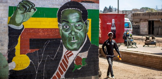 A man walks past a mural of former president Robert Mugabe, in the low income neighbourhood of Mbare, known to have many supporters of Mugabe's ZANU-PF party, in the capital Harare, Zimbabwe Monday, Sept. 9, 2019. Mugabe, who enjoyed strong backing from Zimbabwe's people after taking over in 1980, but whose support waned following decades of repression, economic mismanagement and allegations of election-rigging, is expected to be buried on Sunday, state media reported.