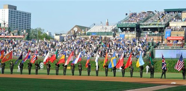 Flags representing the NATO countries are displayed at Wrigley Field in a pregame ceremony before the Cubs/Sox game Saturday.