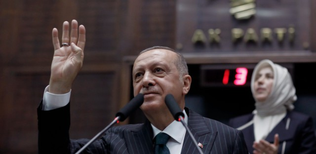 Turkey's President Recep Tayyip Erdogan addresses his ruling party MPs, in Ankara, Turkey, Tuesday, June 25, 2019, two days after Ekrem Imamoglu, the candidate of the secular opposition Republican People's Party, won the election for mayor of Istanbul. Erdogan addressed his AK Party's weekly meeting, the first time he speaks since the Istanbul mayoral election Sunday, which was a big setback for him and his party.