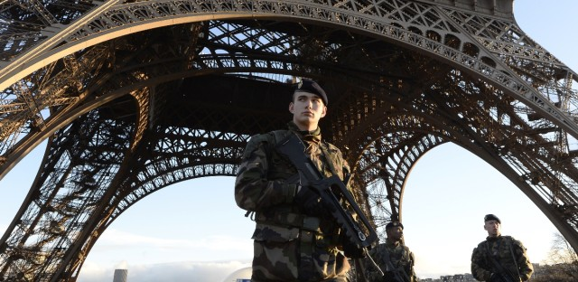 French soldiers patrol in front of the Eiffel Tower on Jan. 8, 2015, the day after a deadly attack on the French satirical newspaper Charlie Hebdo. With bombings Tuesday in Brussels, Europe has now been hit by three major terrorist attacks in just over a year.