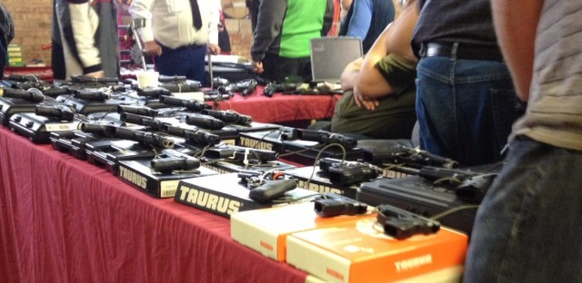 A vendor's table shows the wide variety of weapons available at gun shows in Indiana. President Obama wants to require private sellers of guns to obtain a background check before selling a gun to an individual.