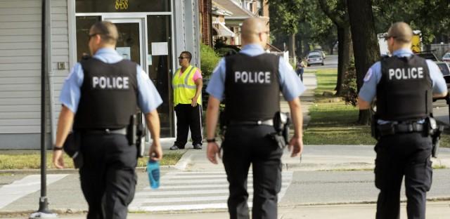 Chicago Police patrol the neighborhood in the Auburn Gresham community in August 2013.