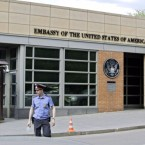 A Russian policeman stands in front of an entrance to the U.S. Embassy in downtown Moscow in 2013.