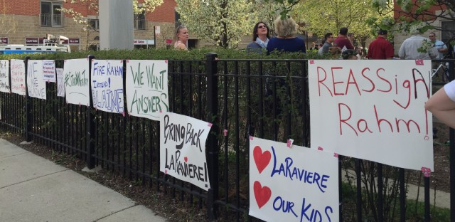 Signs that challenge LaRaviere's reassignment are posted outside of Blane Elementary School on Chicago's North Side.