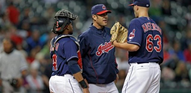 Cleveland Indians pitching coach Scott Radinsky, middle, with Justin Masterson and Carlos Santana.