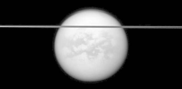 Saturn's rings cut across this view of the planet's largest moon, Titan, in this image taken by the Cassini spacecraft on May 12, 2011.